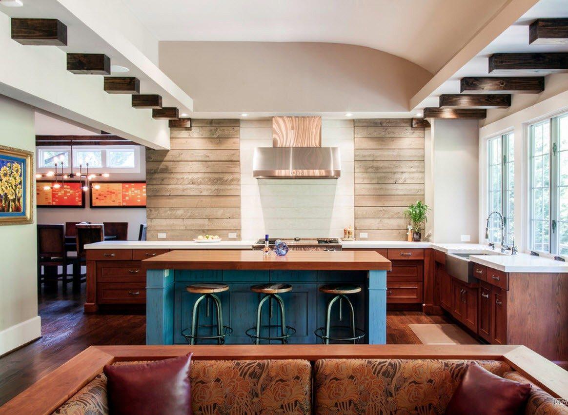 Островная кухня, совмещенная с гостиной, за счет барной тумбы