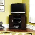 Dark finished wood corner TV stand with under shelving unit and a pair of cabinets