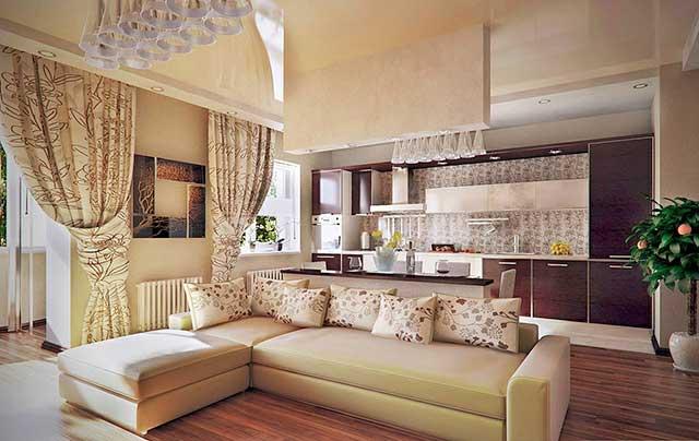 Островное зонирование кухни, совмещенной с гостиной, диваном