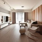 Modern living room with wooden flooring and walls