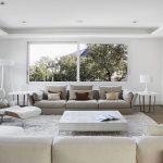 Modern minimalist living room in pristine white