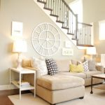 captivating decorate a large living room wall with white classic clock pattern as dim grey ornate design as well as interior design ideas for living rooms plus living room furniture decorating ideas 910x608