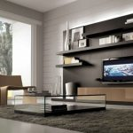 captivating modular furniture coffee tables living room design with glass coffee table on gray area rug and two beige chair plus black wall shelves also tv wall unit along large glass window as well a