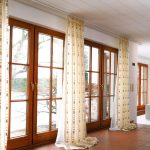 elegant modern living room curtains design beige patterned vertical curtains white long metal rod white colored sofas orange leather chairs living room vertical curtains interior comely design ideas 1