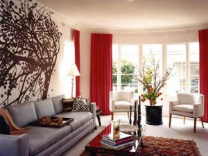 fantastic-tree-wall-mural-also-straight-line-sofa-design-and-glass-coffee-table-plus-awesome-red-living-room-curtain