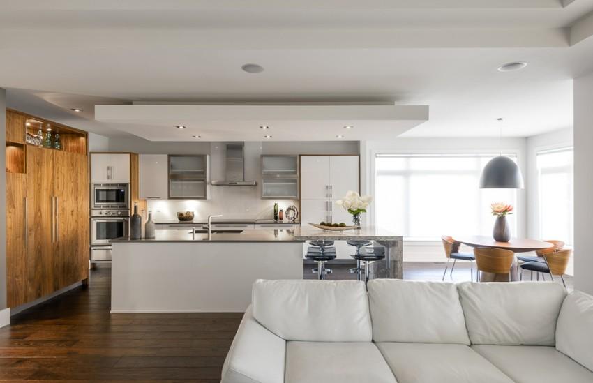 Зонирование гостиной, совмещенной с кухней, при помощи подвесного потолка