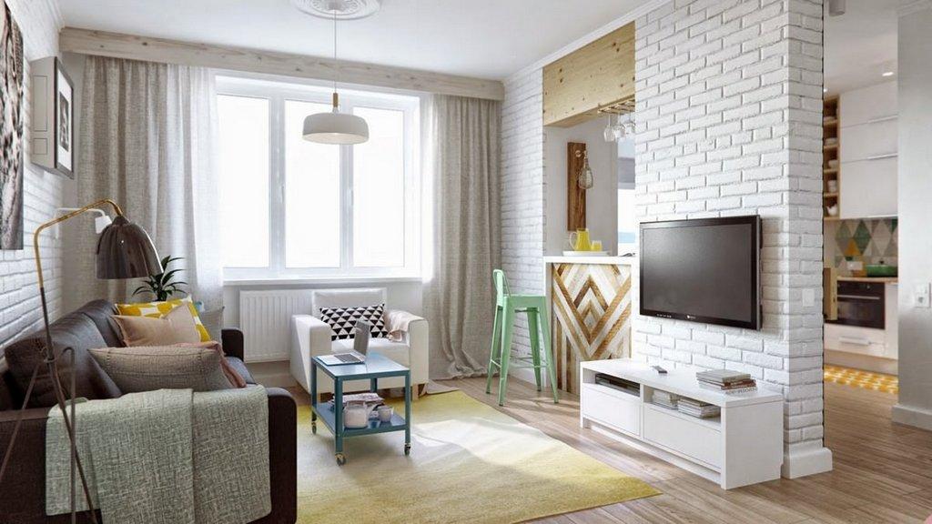 фото разделения кухни, совмещенной с гостиной, кирпичной стеной с барной стойкой