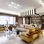 luxurious open plan design interior with elegant decorating and contemporary furniture ideas in living room and dining room with leather brown sectional sofa as well as beautiful floor