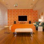 minimalist orange living room in combination with white