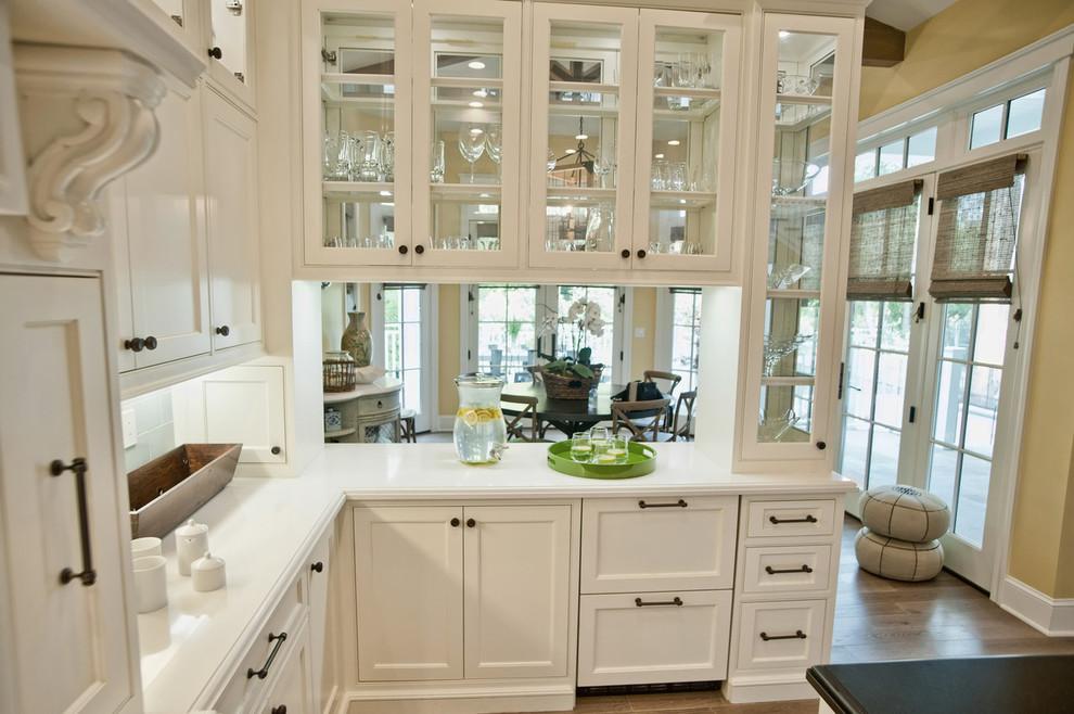 Зонирование кухни гостиной с помощью кухонного гарнитура
