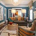 picturesque living room decorating ideas with blue mixed white schemes wall paint and equipped gray fabric couch sofa convertible plus cute colorful themed throw pillows opposite cream drum shape coff