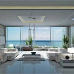 wonderful-sea-view-hotel-room-interior-design-with-large-clear-glass-panelled-walls-and-doors-plus-modern-fabric-living-couches-below-unique-beaded-hanging-lamps-and-square-grey-finish-wooden-tables-o-618x45