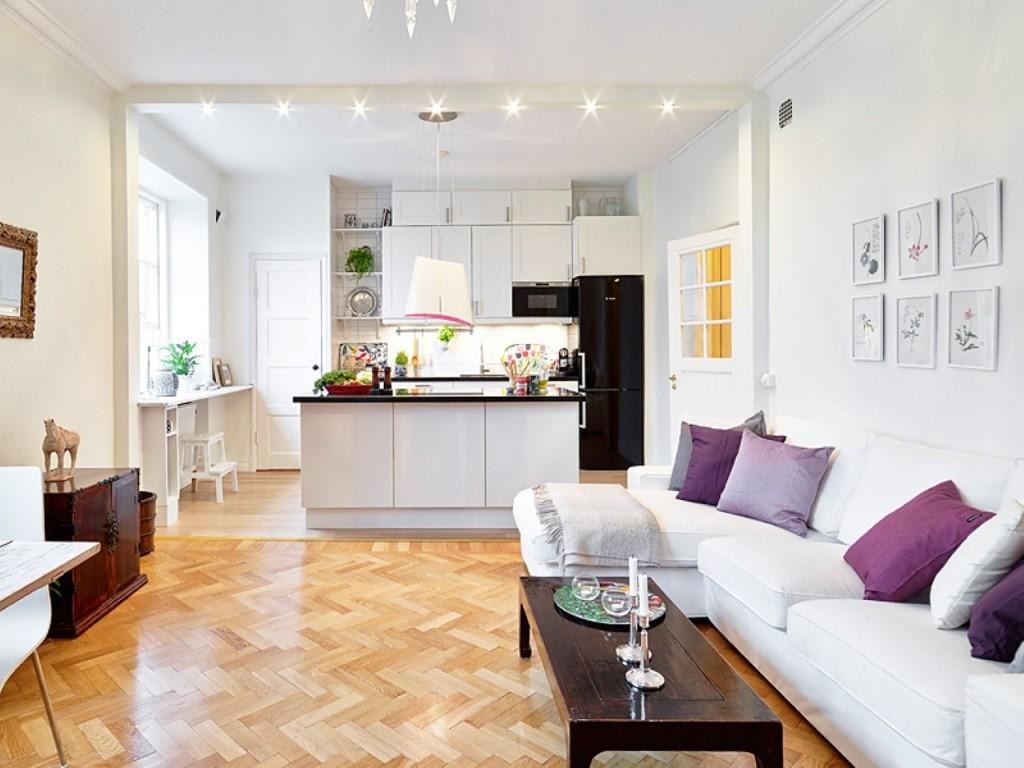 Выделение освещением зоны между кухней и гостиной
